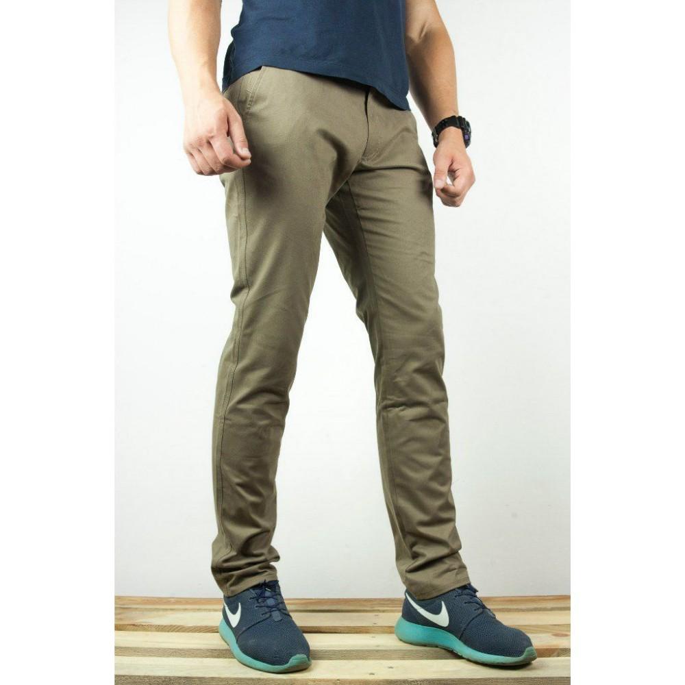 Оливковые брюки доставка