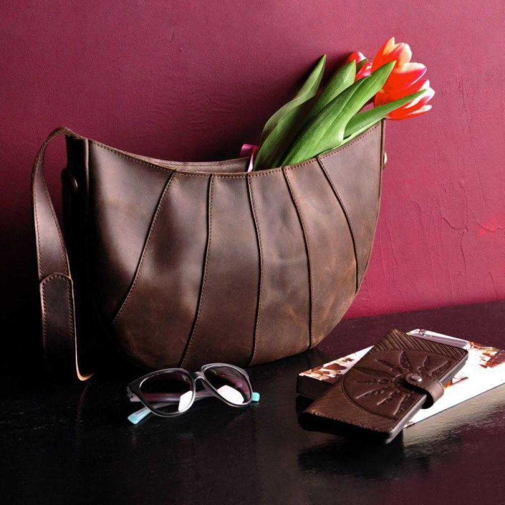 Классическая женская сумка из кожи фото